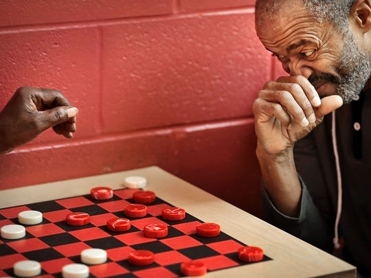 Levi Robinson, 71 (right) keeps an eye on the the competition as he plays checkers with Preston Hurt, 69, at the Orange Mound Community Center Tuesday morning. There is a need for senior activities in the greater Memphis area where census figures show that the elderly population is growing 10 times faster than the area as a whole.