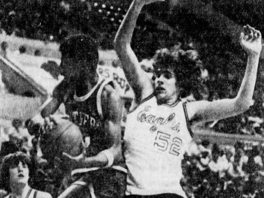 Middletown South's John Benbrook (right) battles for a rebound with Camden's Kevin Wise during the 1979 NJSIAA Group IV semifinal at Rutgers.