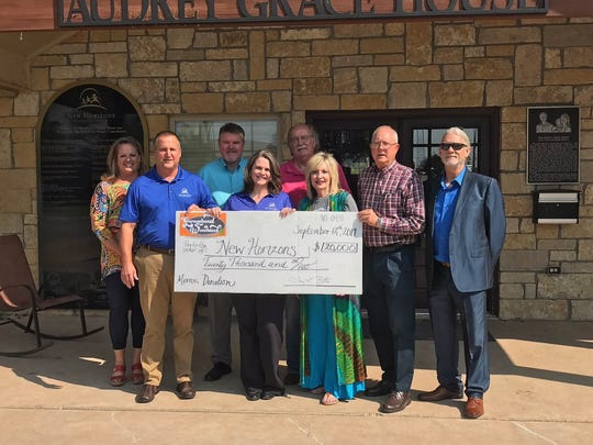 Members of the Garageband Woodstock committee present a $20,000 donation to New Horizons. The funds were the proceeds of Garageband Woodstock VIII, held July 15 at the Taylor County Expo Center. From left: New Horizons members Cara Stone, Mike Redden, Scott Anderson and Hollie White; and Garageband board members Charlie Taylor, Kathy Taylor, Terry Bettis and Doug Roysden.