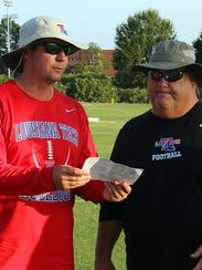 Louisiana Tech quarterbacks coach Tim Rattay, left,