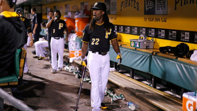 Pittsburgh's Andrew McCutchen carries a bat in the dugout against San Diego in Pittsburgh on Friday. McCutchen went on the disabled list Monday for a rib injury.