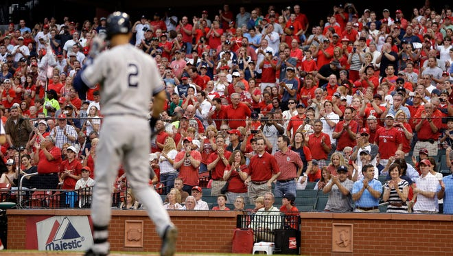 Fans give the Yankees' Derek Jeter a standing ovation as he comes up to bat during the first inning against the St. Louis Cardinals Tuesday night.