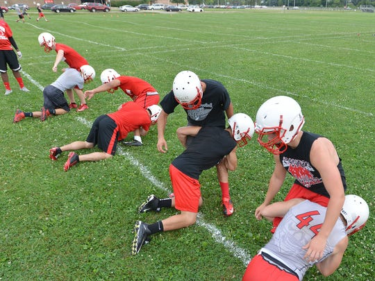 Canton players work on tackling during practice.