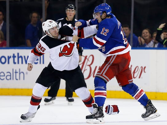 New Jersey Devils right wing Nick Lappin (36) fights