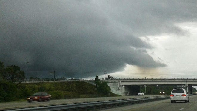 FILE- A strong thunderstorm approaches I-95 in south Brevard County