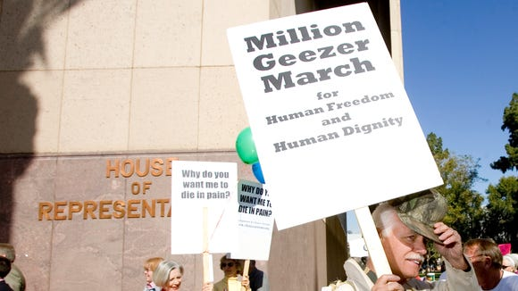 """Jerry Duehr  of Green Valley, walks with others in support of """"dying with dignity"""" legislation outside the Arizona State Capitol in 2006"""