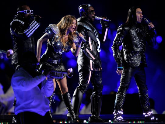 The Black Eyed Peas perform at halftime of Super Bowl