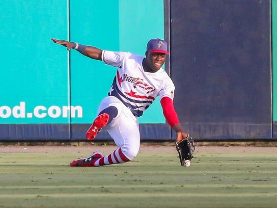 Pensacola right fielder Aristides Aquino (6) tries