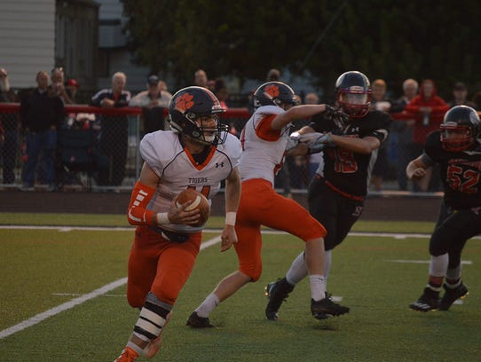 Galion quarterback Harrison Ivy tries to scramble away