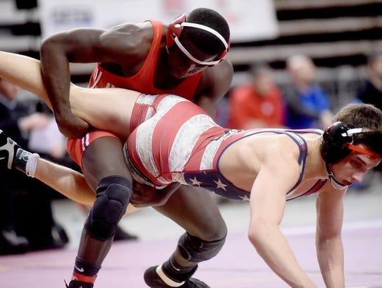 Parkway's Trevor Tamburo wrestles with North DeSoto's