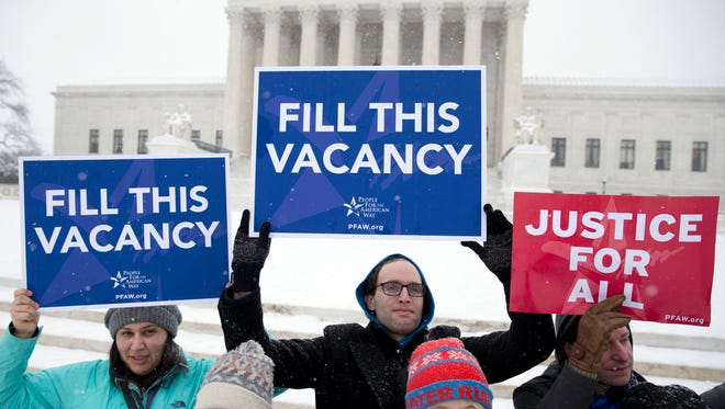 """A group with """"People for the American Way""""  gather with signs in front of the U.S. Supreme Court in Washington, D.C. last week after GOP leaders said they would not consider any nominee from President Barack Obama to the Supreme Court."""