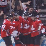 Team Canada forward Jonathan Toews (16) celebrates his second goal of the game against Team Europe with forward Corey Perry (24), defenseman Alex Pietrangelo (27) and forward Logan Couture (39) during preliminary round play in the 2016 World Cup of Hockey at Air Canada Centre.