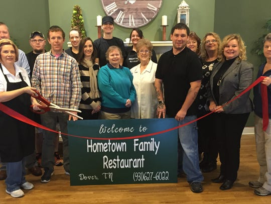 Hometown Family Restaurant co-owner Lesley Outlaw holds