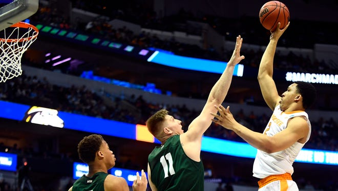 Tennessee forward Grant Williams (2) attempts a shot past Wright State center Loudon Love (11) during the NCAA Tournament first round game between Tennessee and Wright State at American Airlines Center in Dallas, Texas, on Thursday, March 15, 2018.