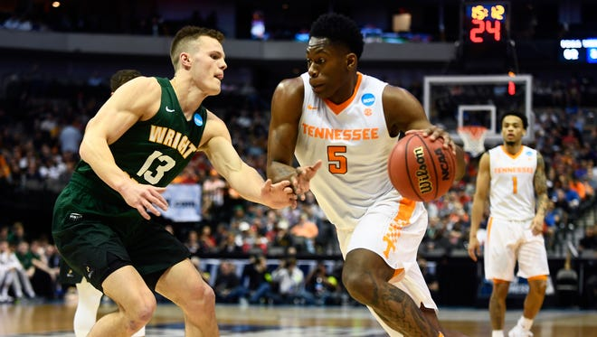 Tennessee forward Admiral Schofield (5) drives past Wright State guard Grant Benzinger (13) during the NCAA Tournament first round game between Tennessee and Wright State at American Airlines Center in Dallas, Texas, on Thursday, March 15, 2018.