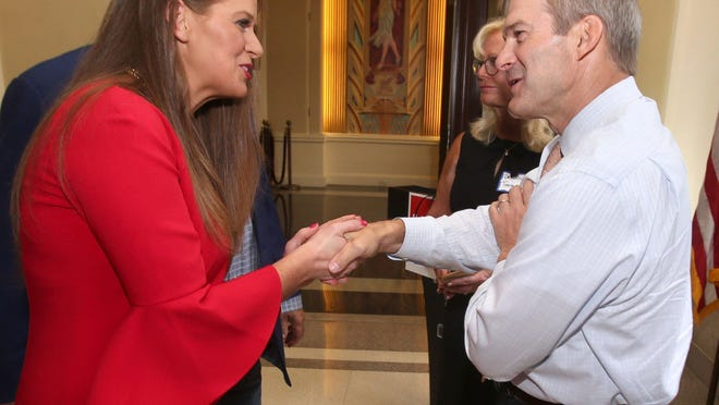 U.S. Rep. Jim Jordan, R-Urbana, a prominent Ohio supporter of President Donald Trump, shakes hands with Republican congressional candidate Christina Hagan during a fundraising event for her at the Historic Onesto Hotel in downtown Canton on Tuesday evening. Hagan is seeking to defeat U.S. Rep. Tim Ryan, D-Howland in the 13th Congressional District, which includes Alliance and Lexington Township.