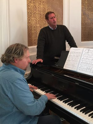 Pianist Brian Helman and tenor Corey Evan Rotz rehearse at Thomson Hall on the Wilson College campus.