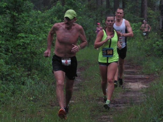 Paul Hoover running in Gulf Winds Track Club's 2016 Potluck Four Mile race.