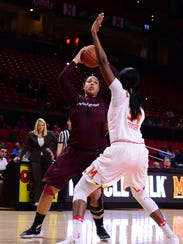 Eastern Shore's Tori Morris with the shot against the