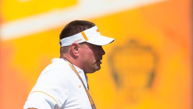 Vols coach Butch Jones watches practice Tuesday, Aug. 15, 2017.