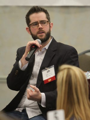 Kyle Psaty of Brand Networks speaks at the luncheon.