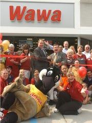 Millville Mayor James Quinn (center, right, with scissors)