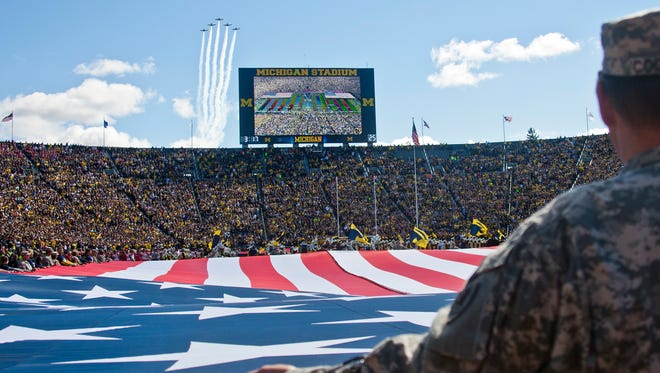 Jets do a flyover during the national anthem before a game between Michigan and Miami (Ohio) in Ann Arbor on Sept. 13, 2014.
