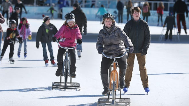 Meghan Doherty glides along with her daughter, Neave Doherty, 11, left, and her skating nephew Liam Leahy, 16, Penfield, as they enjoy a sunny day off.