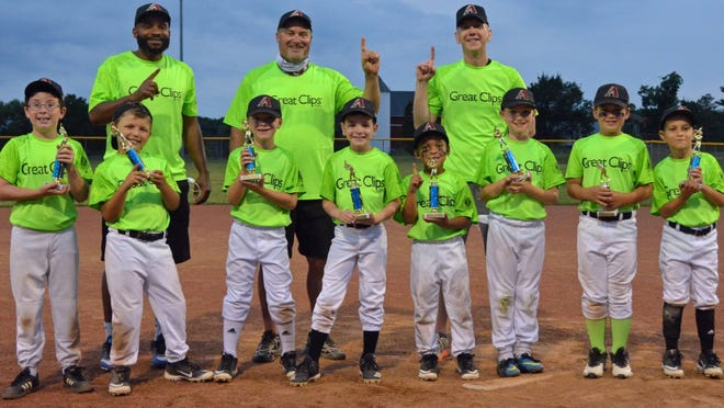 The age 7-and-8 Midget League Diamondbacks earned a 22-16 victory over the Astros in a Hudson Kiwanis Baseball championship game Thursday. Pictured are, front row, from left: Jason Fink, Everett Peller, Connor Sampson, Ben Timbs, McKhai Thompson, Andrew Shott, Henry Beebe and Alex Tsesmelis; and back row: coaches Mac Thompson, Scott Beebe and Ernie Timbs.
