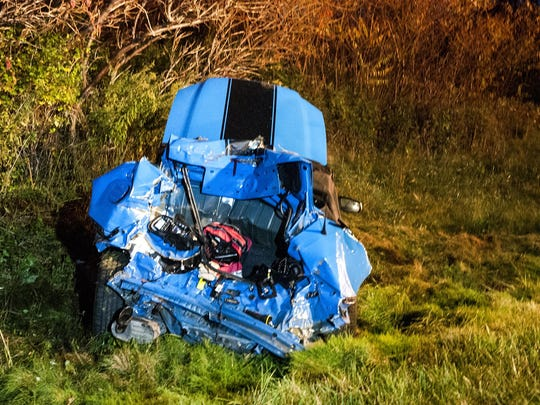 The Ford Mustang convertible was trying to avoid a deer when it was struck from behind.
