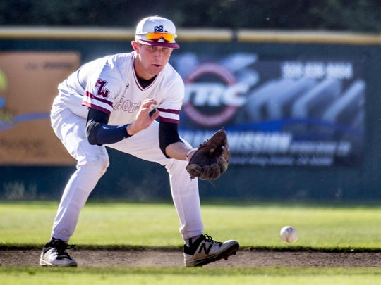 Mt. Whitney's Holden Powell fields a batted ball against
