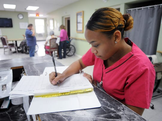 Certified Nursing Assistant Andrea Hartwell at work at Elant in Wappingers Falls. Journal file photo from 2013.