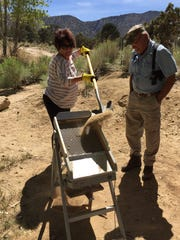 Joe Falcone looks on as Ann D'Amico of Palm Springs shovels dirt into a drywasher at Vaughn Spring in Rattlesnake Canyon on Wednesday, April 29, 2015.