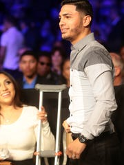 International Boxing Federation Bantamweight world champion Randy Caballero looks out at the crowd with his crutches nearby on Friday night, February 27, 2015 at Fantasy Springs Resort Casino in Indio, Calif. during a televised Golden Boy Boxing event. Caballero was supposed to defend his title during the event, but had to pull out due to an injury sustained during training.
