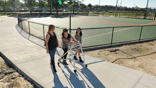 The poster child for this project is Brittany Klenotich, who is now 16, and has cerebral palsy. She is seen here walking past a ball field surfaced with recycled rubber, with her mom, Denise and her younger sister Jasmine Jade, 11. The construction of Brevard Field of Dreams in West Melbourne continues, and they will have a community build November 11-15 for this sports and playground complex for the disabled. They are located at the former site of Max K. Rodes park at Minton Road, and Fell Road.