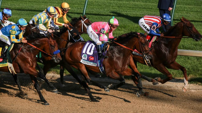 American Pharoah stayed near as Dortmund and jockey Martin Garcia, right, and Firing Line and jockey Gary Stevens fought for the lead in the first stretch.