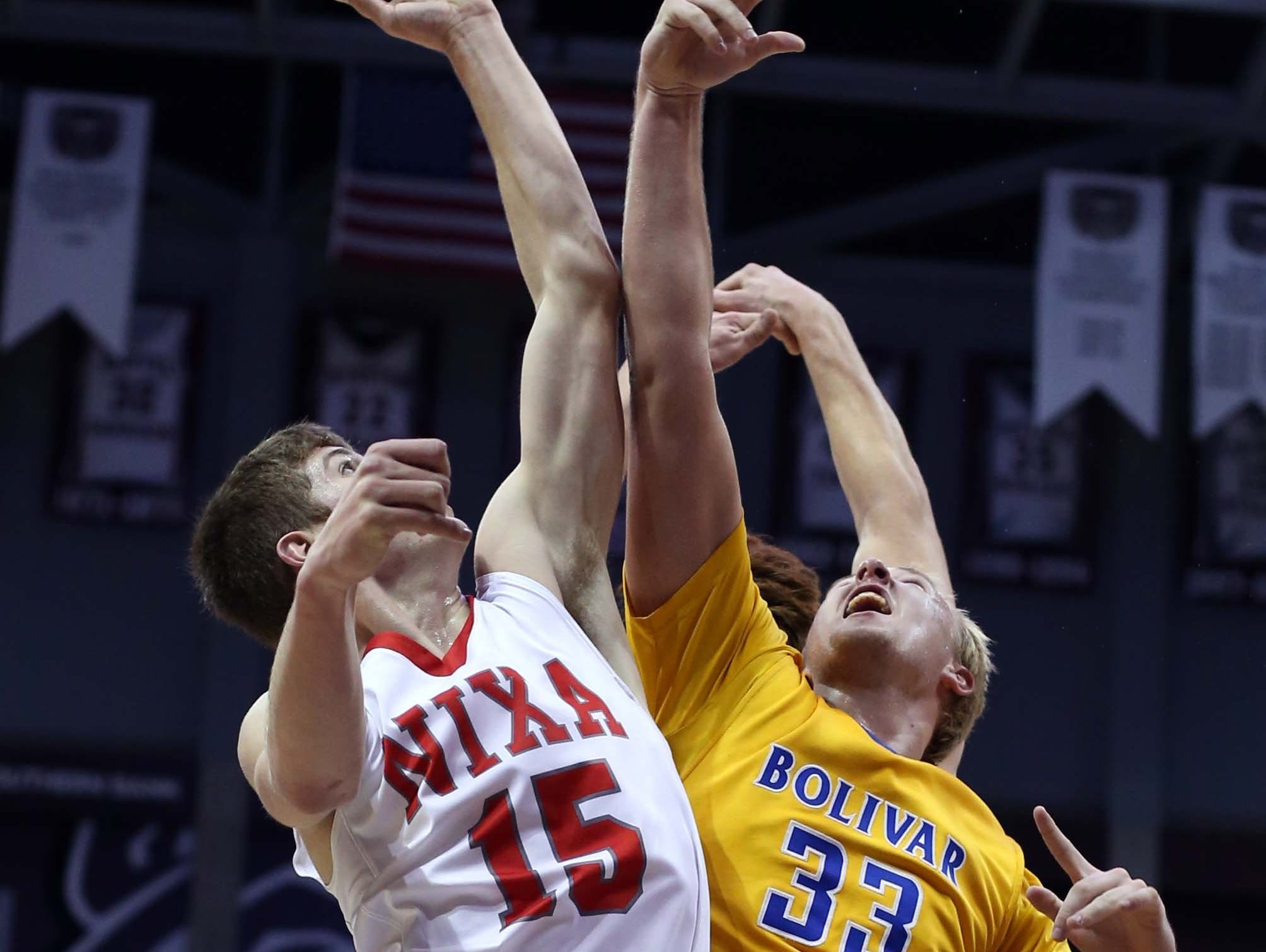 Bolivar's Brandon Emmert (right) battles for a rebound during the final round of the 70th Greenwood Blue and Gold Tournament.