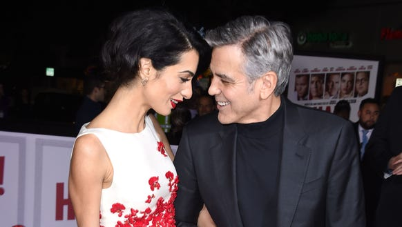 George Clooney walks the premiere red carpet with wife