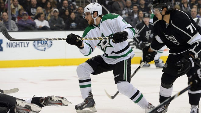 Dallas Stars center Tyler Seguin scores a goal as Los Angeles Kings center Jordan Nolan looks on in the first period of the game at Staples Center.