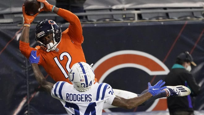 Chicago Bears' Allen Robinson (12) makes a touchdown reception against Indianapolis Colts' Isaiah Rodgers (34) during the second half of an NFL football game, Sunday, Oct. 4, 2020, in Chicago.