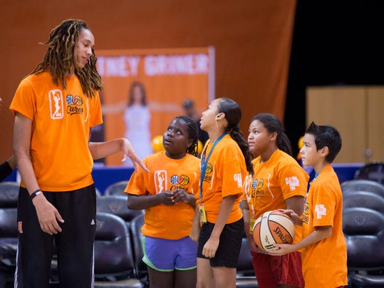 WNBA All-Star Brittney Griner, of the Phoenix Mercury, speaks with children from Phoenix area Boys and Girls Clubs during a basketball clinic at U.S. Airways Center in Phoenix, Friday, July 18, 2014. The WNBA All-Star game couldn't be held in a more appropriate place this season than in Phoenix, where the Mercury are 17-3 and riding an 11-game winning streak. (AP Photo/The Arizona Republic, Cheryl Evans)  MARICOPA COUNTY OUT; MAGS OUT; NO SALES