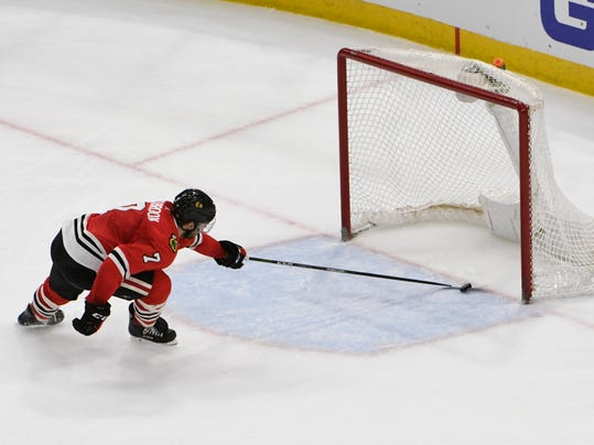 Chicago Blackhawks defenseman Brent Seabrook (7) is unable to keep the puck out of the net on a goal by Colorado Avalanche defenseman Erik Johnson during the third period of an NHL hockey game Tuesday, March 20, 2018, in Chicago. The Avalanche won 5-1. (AP Photo/David Banks)