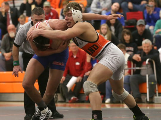 Ashland's 2016 state medalist Sid Ohl had a battle on his hands, but prevailed 4-2 over West Holmes' Cody Woods in their 152-pound bout during Wednesday's regional semifinals of the state team wrestling tournament.