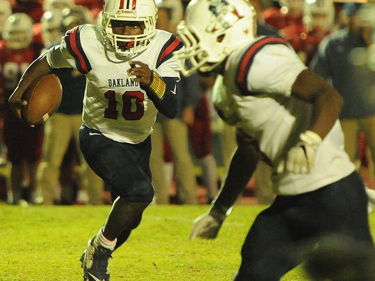 Oakland quarterback Timmy Goodrich looks for running room during the Patriots' 35-14 win over Cookeville Friday.