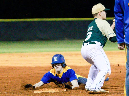 Travelers Rest's Parker Neff slides into third. Travelers Rest hosted Berea in boys varsity baseball action March 8, 2016