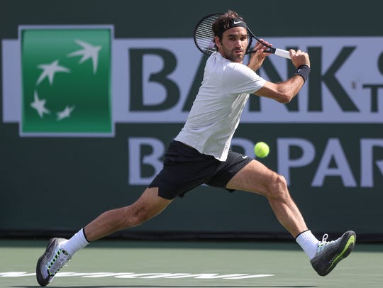 Roger Federer hits a shot during his loss to Juan Martin