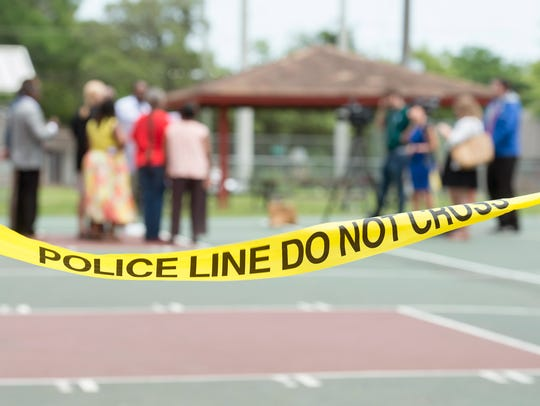 Police tape remains around the Fricker Community Center