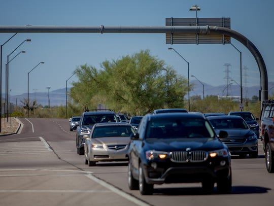 Cars drive down Hayden Road on Wednesday, June 20,