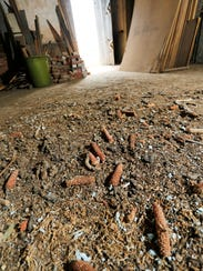 Corn cobs litter the floor of the old Morris School,