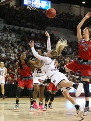 Mississippi State's Blair Schaefer (1) is fouled as